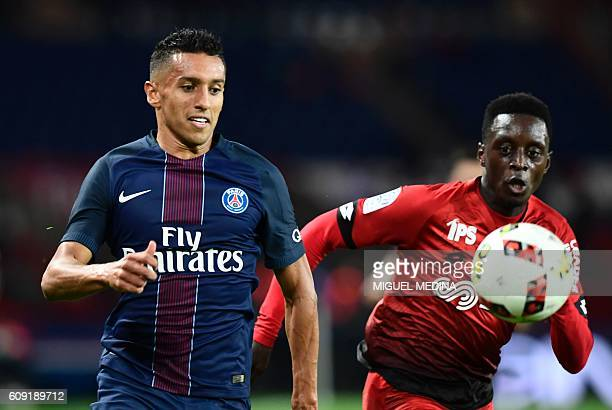 Paris SaintGermain's Brazilian defender Marquinhos vies with Dijon's FrenchCongolese defender Arnold Bouka Moutou during the French Ligue 1 football...
