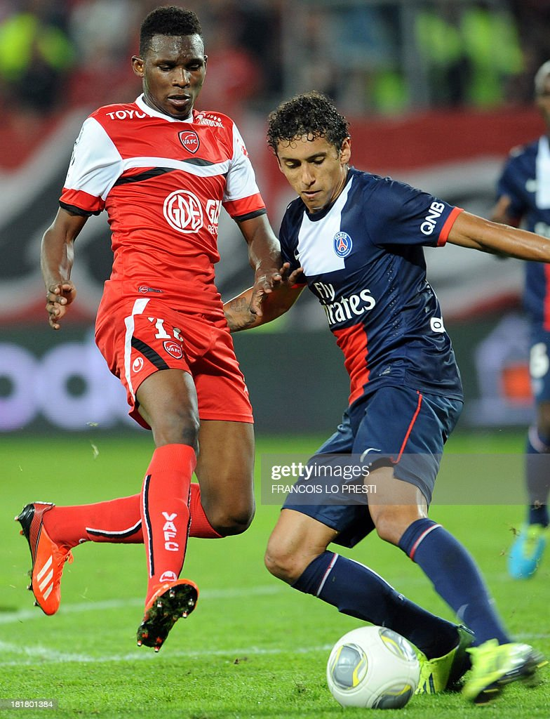 Paris Saint-Germain's Brazilian defender Marquinhos (R) vies with Valenciennes' French defender Kenny Lala during a French L1 football match between Valenciennes and Paris Saint-Germain on September 25, 2013 at the Stade du Hainaut in Valenciennes, northern France.