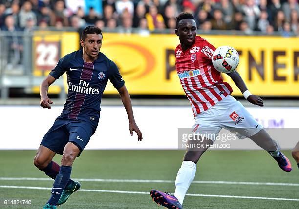 Paris SaintGermain's Brazilian defender Marquinhos vies with Nancy's SpanishUruguayan defender Erick Cabaco during the French L1 football match...