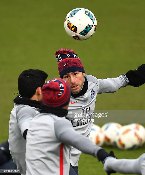 Paris SaintGermain's Brazilian defender Maxwell eyes the ball during a training session on January 28 2017 in SaintGermainenLaye western Paris on the...