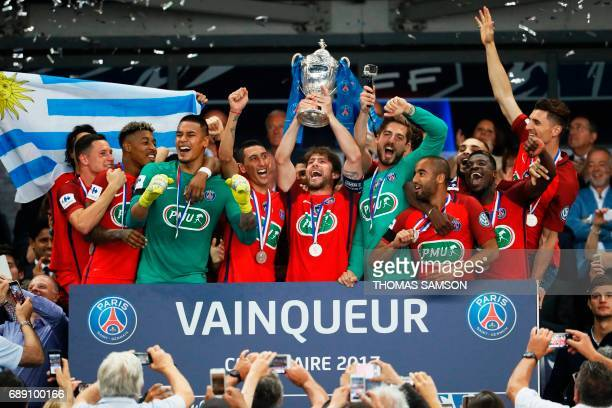 Paris SaintGermain's Brazilian defender Maxwell holds the trophy as he celebrates winning the French Cup final football match between Paris...