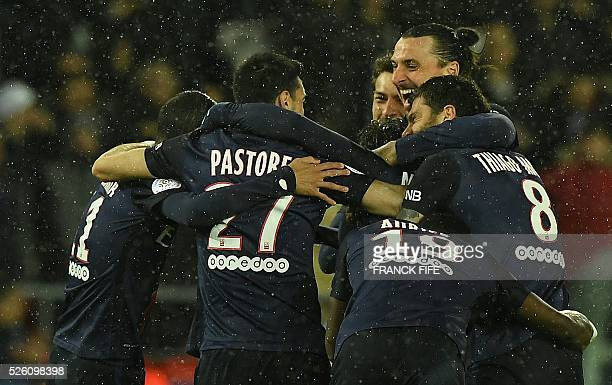 TOPSHOT Paris SaintGermain's Brazilian defender Maxwell is congratulated by teammates after scoring a goal during the French L1 football match...