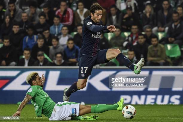 Paris SaintGermain's Brazilian defender Maxwell is tackled by SaintEtienne's French defender Kevin Malcuit during the L1 football match between AS...