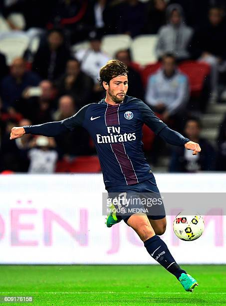 Paris SaintGermain's Brazilian defender Maxwell kicks the ball during the French L1 football match between Paris SaintGermain and Dijon at the Parc...