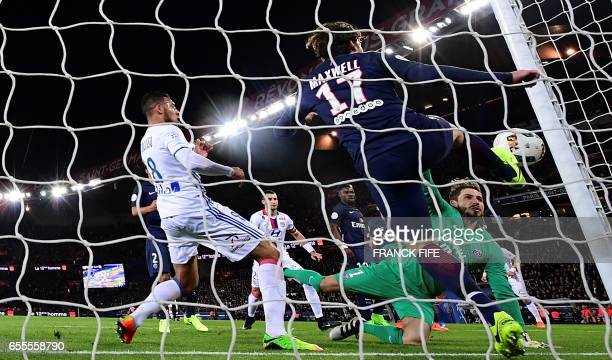 Paris SaintGermain's Brazilian defender Maxwell kicks the ball in front of Paris SaintGermain's German goalkeeper Kevin Trapp and Lyon's French...