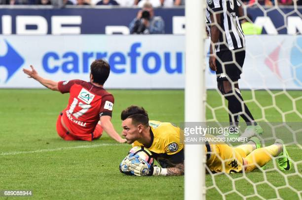 Paris SaintGermain's Brazilian defender Maxwell reacts as Angers' French goalkeeper Alexandre Letellier catches the ball during the French Cup final...