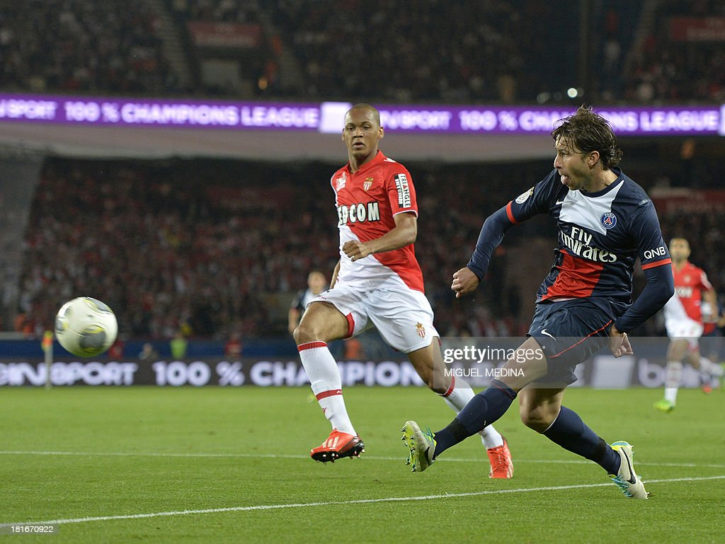 Paris Saint-Germain's Brazilian defender Maxwell (R) strikes during the French L1 football match between Paris Saint-Germain and AS Monaco at the Parc des Princes Stadium in Paris on September 22, 2013.