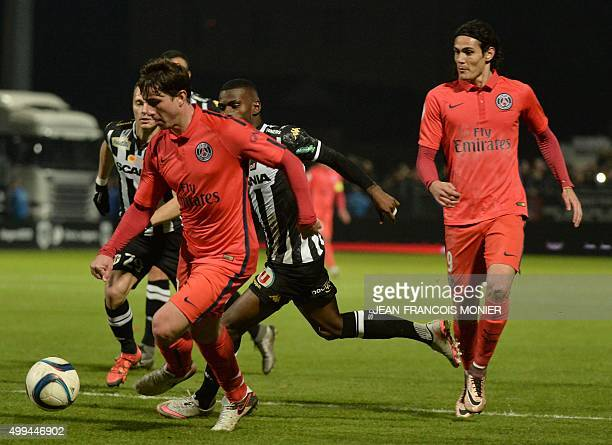 Paris SaintGermain's Brazilian defender Maxwell vies with Angers' Guinean midfielder Abdoul Camara and Paris SaintGermain's Uruguayan forward Edinson...