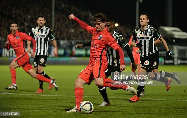 Paris SaintGermain's Brazilian defender Maxwell vies with Angers' Guinean midfielder Abdoul Camara during the French L1 football match between Angers...