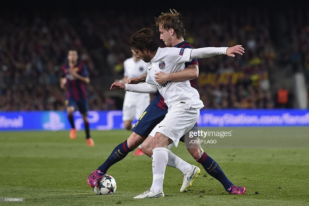 Paris Saint-Germain's Brazilian defender <a gi-track='captionPersonalityLinkClicked' href=/galleries/search?phrase=Maxwell+-+Brazilian+Soccer+Player&family=editorial&specificpeople=546154 ng-click='$event.stopPropagation()'>Maxwell</a> (L) vies with Barcelona's Croatian midfielder <a gi-track='captionPersonalityLinkClicked' href=/galleries/search?phrase=Ivan+Rakitic&family=editorial&specificpeople=3987920 ng-click='$event.stopPropagation()'>Ivan Rakitic</a> during the UEFA Champions League quarter-finals second leg football match FC Barcelona vs Paris Saint-Germain at the Camp Nou stadium in Barcelona on April 21, 2015.