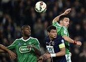 Paris SaintGermain's Brazilian defender Thiago Silva and SaintEtienne's Turkish forward Mevlut Erding go for a header during the French Cup semifinal...