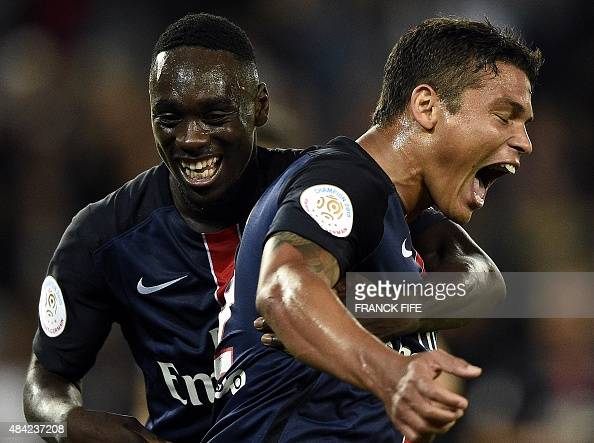 Paris SaintGermain's Brazilian defender Thiago Silva celebrates with Paris SaintGermain's French forward Jean Kevin Augustin after scoring during the...