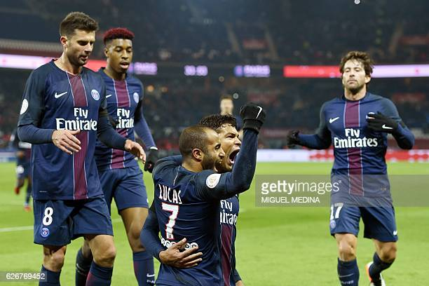 Paris SaintGermain's Brazilian defender Thiago Silva celebrates with Paris SaintGermain's Brazilian midfielder Lucas Moura after scoring during the...