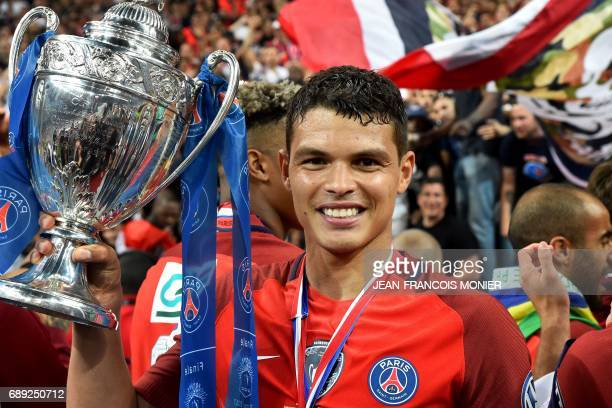 Paris SaintGermain's Brazilian defender Thiago Silva celebrates with the trophy after winning the French Cup final football match between Paris...