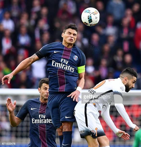 Paris SaintGermain's Brazilian defender Thiago Silva heads the ball next to Montpellier's French midfielder Ryad Boudebouz during the French L1...