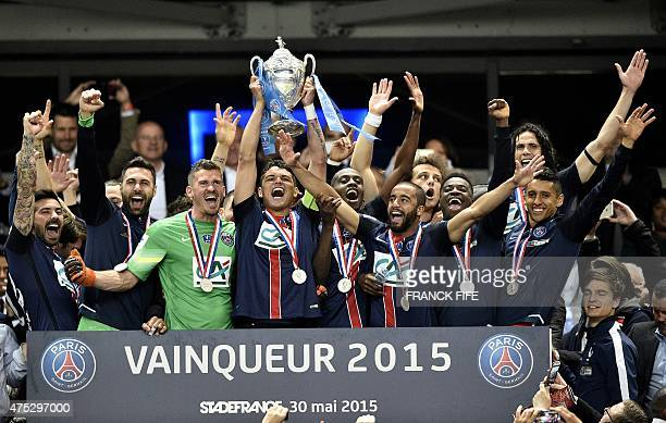 Paris SaintGermain's Brazilian defender Thiago Silva holds up the trophy as Paris SaintGermain's players celebrate after winning the French Cup final...