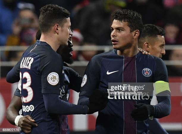 Paris SaintGermain's Brazilian defender Thiago Silva is congratulated by teammate Paris SaintGermain's German forward Julian Draxler after scoring...
