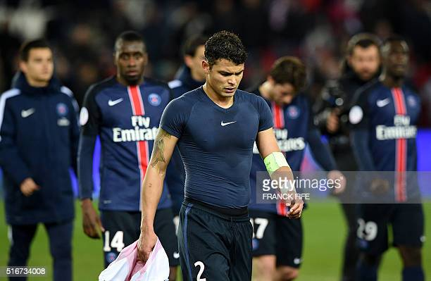 Paris SaintGermain's Brazilian defender Thiago Silva leaves with teammates at the end of the French L1 football match between Paris SaintGermain and...