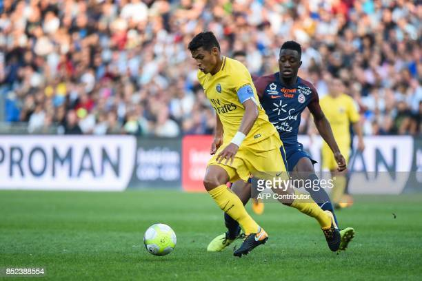 Paris SaintGermain's Brazilian defender Thiago Silva outruns Montpellier's French forward Isaac Mbenza during the French Ligue 1 football match...