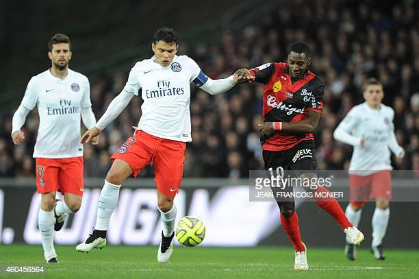 Paris SaintGermain's Brazilian defender Thiago Silva vies for the ball with Guingamp's French forward Cedric Faure during the French L1 football...