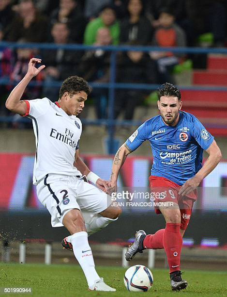 Paris SaintGermain's Brazilian defender Thiago Silva vies for the ball with Caen's French forward Andy Delort during the French L1 football match...
