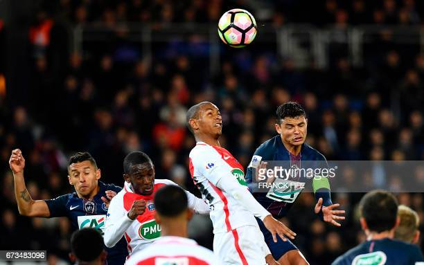Paris SaintGermain's Brazilian defender Thiago Silva vies for the ball with Monaco's French defender Abdou Diallo during the French Cup semifinal...