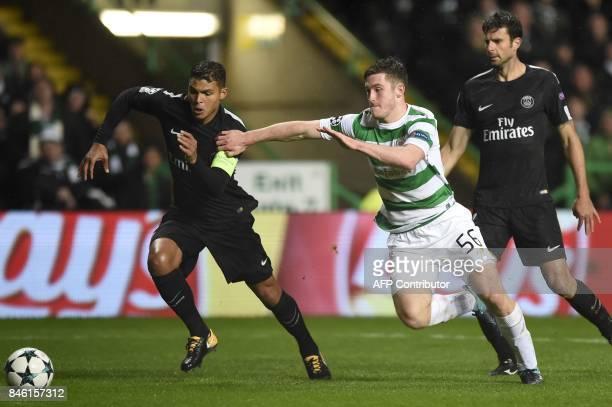 Paris SaintGermain's Brazilian defender Thiago Silva vies with Celtic's Scottish defender Anthony Ralston during the UEFA Champions League Group B...