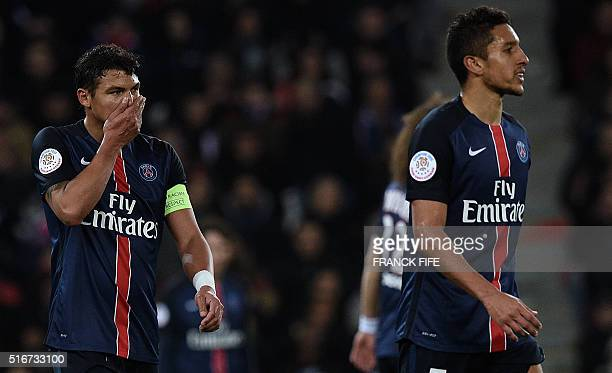 Paris SaintGermain's Brazilian defenders Thiago Silva and Marquinhos react after AS Monaco scored a goal during the French L1 football match between...