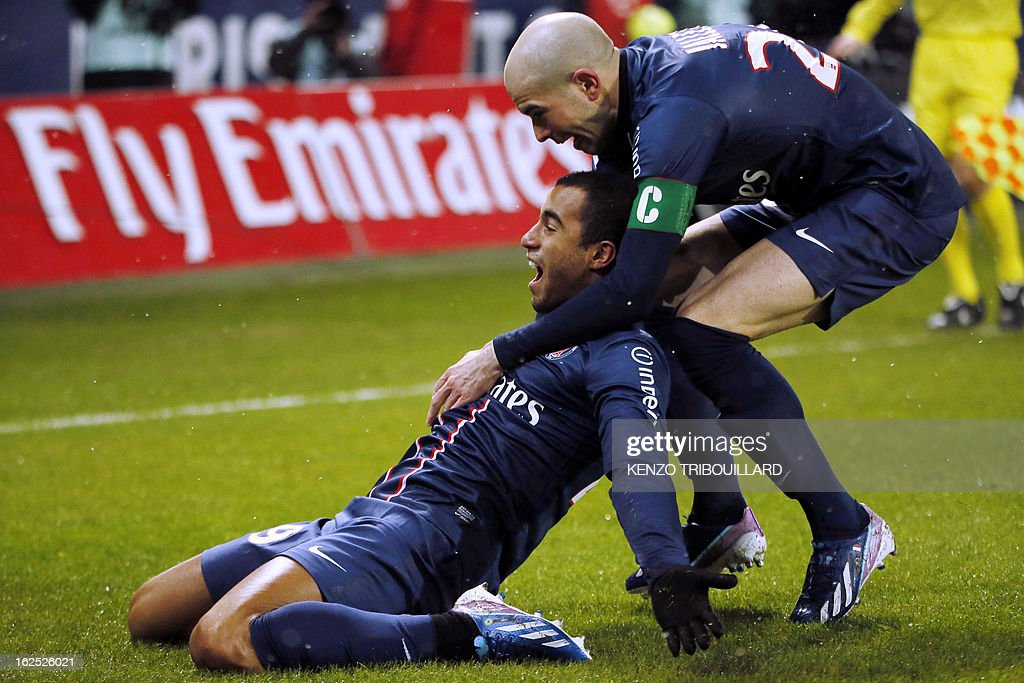 Paris Saint-Germain's Brazilian forward Lucas Moura celebrates with teammate Paris Saint-Germain's French defender Christophe Jallet after scoring during the French L1 football match Paris Saint-Germain (PSG) vs Olympique de Marseille (OM) on February 24, 2013 at the Parc des Princes stadium in Paris. AFP PHOTO KENZO TRIBOUILLARD