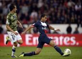Paris SaintGermain's Brazilian forward Lucas Moura controls the ball in front of Bastia's Algerian defender Fethi Harek during the French L1 football...