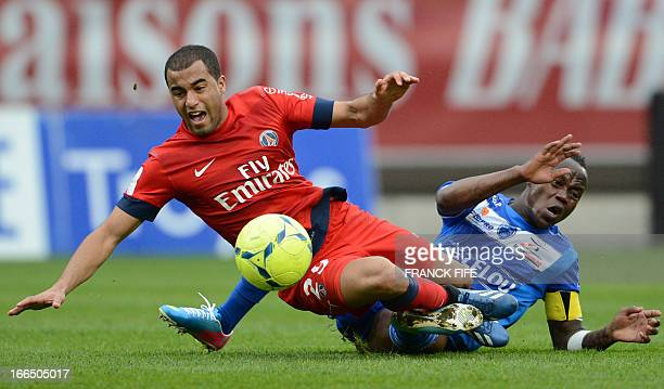 Paris SaintGermain's Brazilian forward Lucas Moura is tackled by Troyes' French defender Eloge EnzaYamissi during the French L1 football match Troyes...