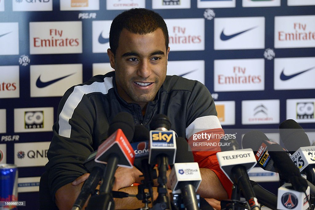 Paris Saint-Germain's Brazilian forward Lucas Moura smiles as he gives a press conference on April 19, 2013 at the French L1 football club PSG's training camp in Saint-Germain-en-Laye, near Paris. AFP PHOTO / BERTRAND GUAY