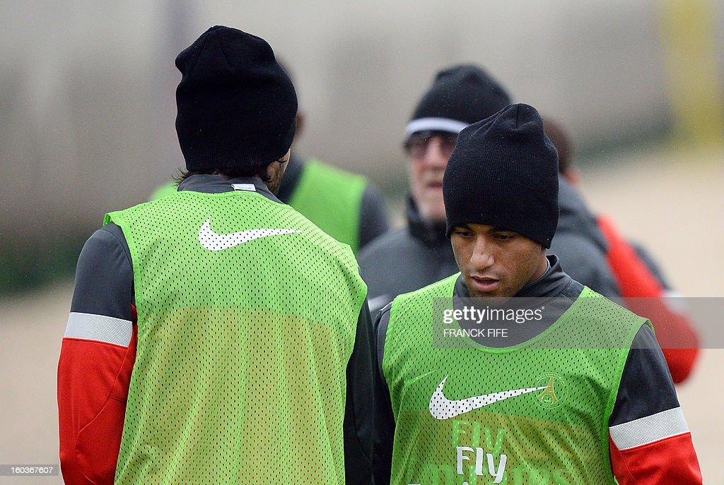 Paris Saint-Germain's Brazilian forward Lucas Moura (R) takes part in a training session on January 30, 2013 at the Camp des Loges in Saint-Germain-en-Laye, west of Paris.