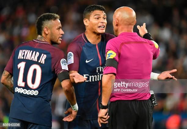 Paris SaintGermain's Brazilian forward Neymar and Paris SaintGermain's Brazilian defender Thiago Silva talk to French referee Amaury Delerue during...