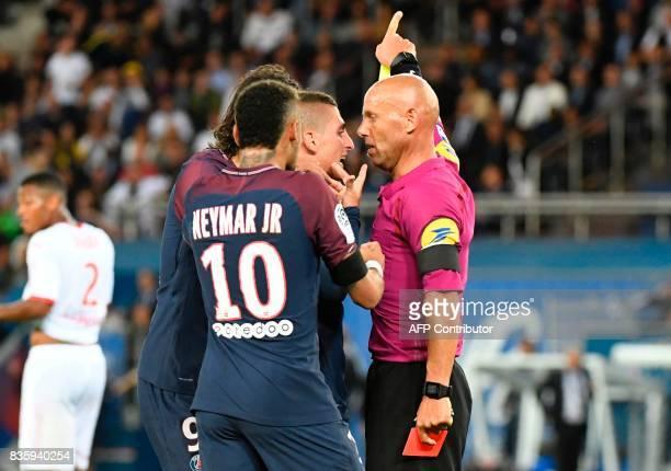 Paris SaintGermain's Brazilian forward Neymar and Paris SaintGermain's Italian midfielder Marco Verratti talk to French referee Amaury Delerue during...