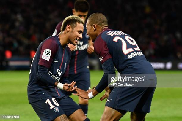 Paris SaintGermain's Brazilian forward Neymar and Paris SaintGermain's French forward Kylian Mbappe celebrate a second goal during the French L1...