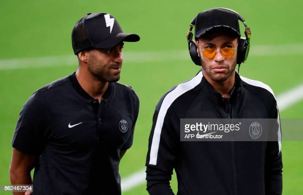 Paris SaintGermain's Brazilian forward Neymar and Paris SaintGermain's Brazilian forward Lucas attend a training session at the Constant Vanden Stock...