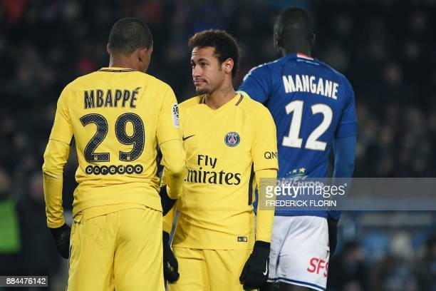 TOPSHOT Paris SaintGermain's Brazilian forward Neymar and Paris SaintGermain's French forward Kylian Mbappe react during the French L1 football match...