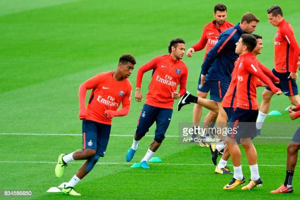 Paris SaintGermain's Brazilian forward Neymar and teammates take part in a training session at the Camp des Loges in SaintGermainenLaye near Paris on...