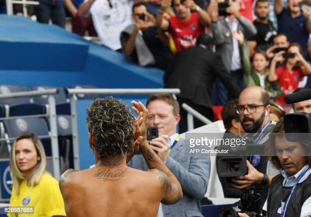 Paris SaintGermain's Brazilian forward Neymar applauds to the crowd during his presentation to the fans at the Parc des Princes stadium in Paris on...