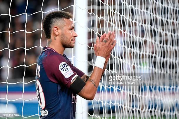 TOPSHOT Paris SaintGermain's Brazilian forward Neymar applauses after winning the French L1 football match Paris SaintGermain vs Toulouse FC at the...