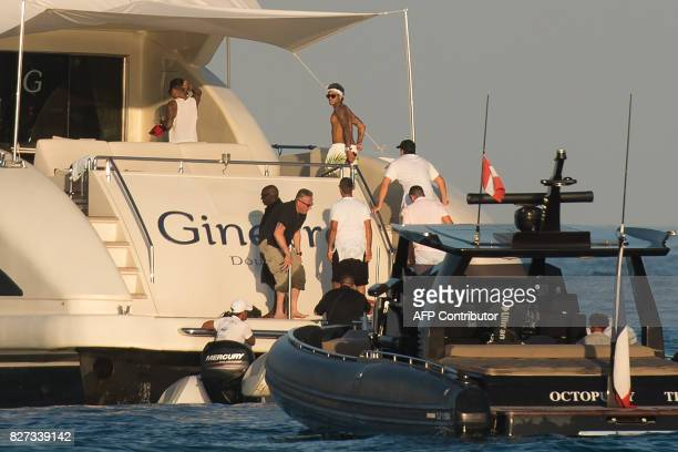 TOPSHOT Paris SaintGermain's Brazilian forward Neymar boards a yacht after leaving a beach in Ramatuelle southeastern France on August 7 2017 two...