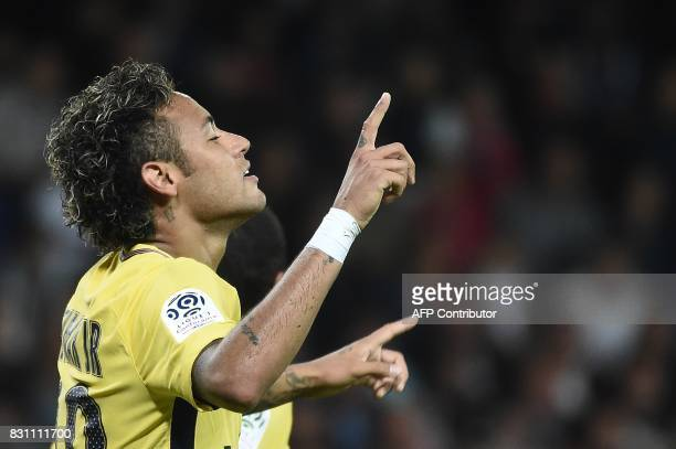 Paris SaintGermain's Brazilian forward Neymar celebrates after scoring a goal during the French L1 football match Paris SaintGermain vs En Avant...