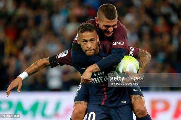 Paris SaintGermain's Brazilian forward Neymar celebrates after scoring a goal with his teammate Paris SaintGermain's Italian midfielder Marco...