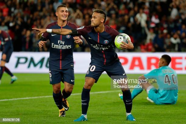 Paris SaintGermain's Brazilian forward Neymar celebrates after scoring a goal next to Paris SaintGermain's Italian midfielder Marco Verratti during...