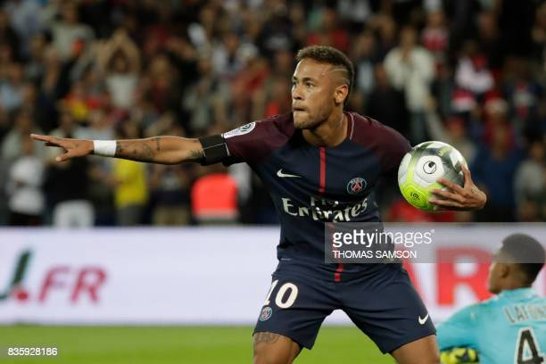 TOPSHOT Paris SaintGermain's Brazilian forward Neymar celebrates after scoring a goal during the French L1 football match Paris SaintGermain vs...