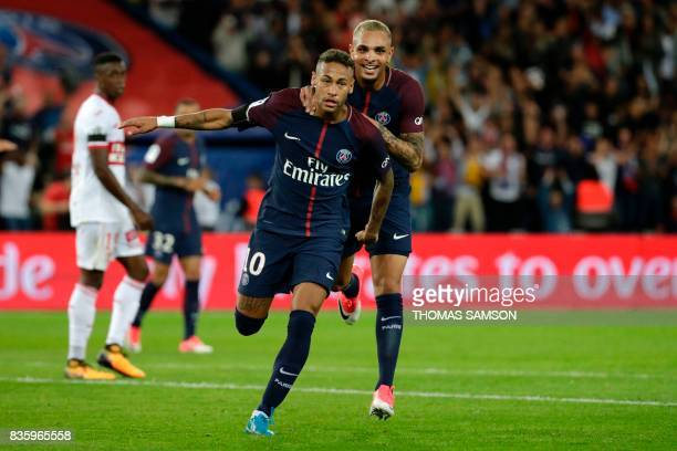 Paris SaintGermain's Brazilian forward Neymar celebrates after scoring a goal with Paris SaintGermain's French defender Layvin Kurzawa during the...