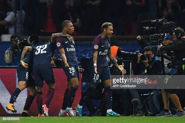 Paris SaintGermain's Brazilian forward Neymar celebrates after scoring a goal during the UEFA Champions League football match between Paris...