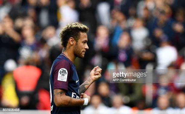 Paris SaintGermain's Brazilian forward Neymar celebrates after scoring a penalty kick during the French L1 football match Paris SaintGermain vs...