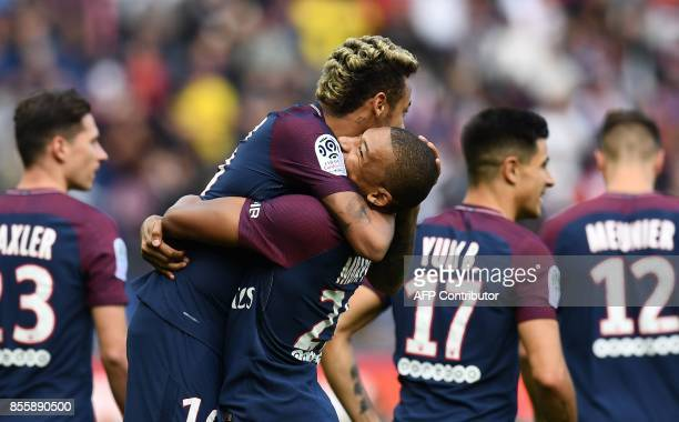 TOPSHOT Paris SaintGermain's Brazilian forward Neymar celebrates scoring the opening goal with Paris SaintGermain's French forward Kylian Mbappe...